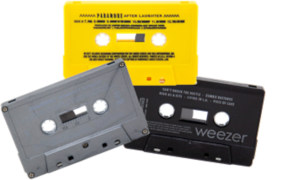 Cassette duplication example image - grey, yellow, and black tape shells
